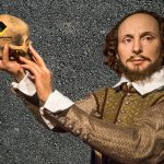 Realistic wax figure of Shakespeare holds skull with Black Diamond Paving logo on it